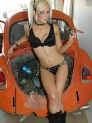 Sexy petite blonde Lindsay Marie gets dirty working on a car