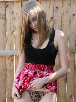 Blonde teen Mandy Roe strips out of her dress outside