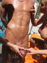 Hot college coeds give a wild reverse gangbang by the pool