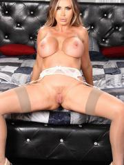 Nikki Benz gives a striptease in bed