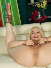 Blonde hottie Sarah Vandella fingers her wet pussy on the couch