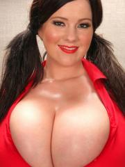 Busty babe Rachel Aldana tries to contain those massive jugs of hers