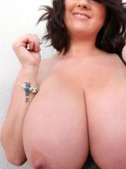 Rachel Aldana drops her bra to reveal her huge natural tits