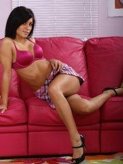 Pictures of teen porn girl Raven Riley fingering her pussy on the couch