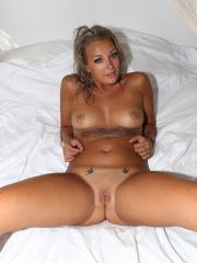 Blonde college coed gets naked for you in bed
