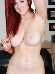 Redhead Rosie gets totally naked and plays with her shaved pussy