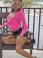 Hot girl Salina Ford pulls down her skirt and panties on the balcony