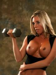 Samantha Saint gets hot while working out and has to remove some clothes