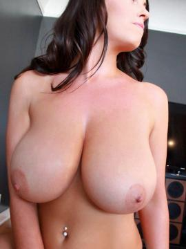 Sarah Nicola Randall removes her bra to show off her big natural boobs for the camera