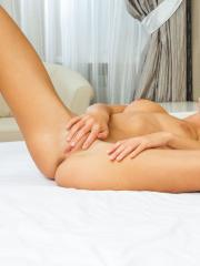 Blonde hottie Xena slides off her panties and fondles her wet pussy in bed