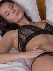 Vanessa Angel strips off her black lace lingerie and starts pleasing her pussy