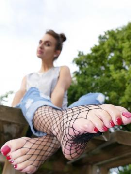 Sexy Lena  shows off her feet outside