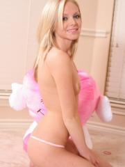 Blonde teenage babe Skye strips out of her hot pink fishnet dress exposing her perfect perky breasts