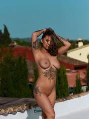 Mica Martinez strips out of her see-through bodysuit outside