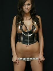 Busty hottie London Hart teases in polkadot panties and a corset