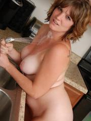 Sexy hot babe Misty strips naked in the kitchen and cools off when she sprays her tits with water