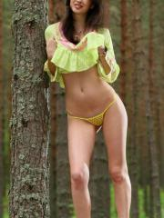 "Brunette teen Ganna A gets naked in the forest in ""Great Smile"""