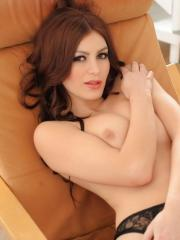 Summer St Claire lays back in her fishnet stockings and black lingerie