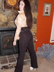 Sweet Krissy slides down her pants by the fireplace just for you