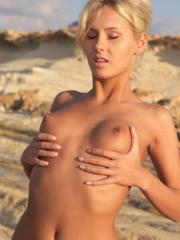 Blonde babe Zuzanna strips out of her bikini on the beach