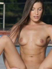 Brunette babe Ennie Harris strips for you by the pool