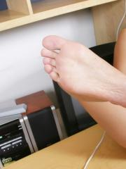 Teen hottie Terry Lightspeed plays with her feet while on the phone