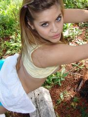 Cute girl Topanga poses outside in her little outfit