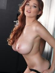 Redhead babe Tessa Fowler lets her huge tits go free