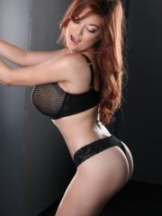 Busty redhead babe Tessa Fowler poses and teases in her bra and panties