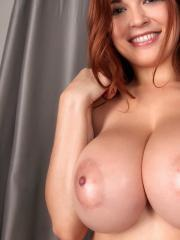 Redhead beauty Tessa Fowler shows off her huge all natural 32GGs