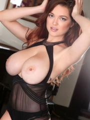 Busty girl Tessa Fowler displays her big natural boobs in black sheer lingerie