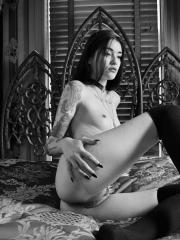 Ari Dee poses nude in her beautiful gothic bed