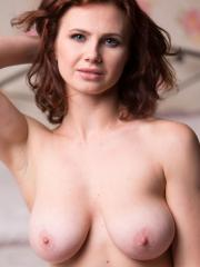 "Busty redhead Aphrodita gives you her hot nude body in ""Charming"""