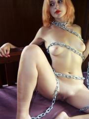"""Beautiful redhead Kristell chains herself up for you in """"Belle Femme"""""""