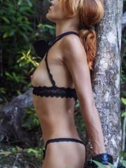 "Redhead model Lesma cuffs herself outside in ""Enduring"""