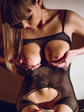 """Natalie Russ playing with clothes-pins in """"Depraved"""""""