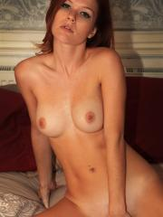 Pictures of redhead girl Mia Sollis fingering her wet pussy in bed
