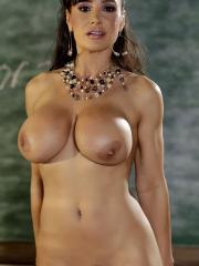Busty teacher Lisa Ann gets horny after class and has to strip in the classroom