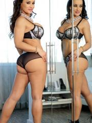 Lisa Ann strips naked and sucks a dildo by the mirror