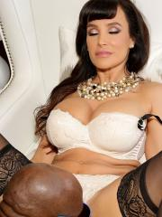 Busty brunette Lisa Ann gets fucked by a big black cock