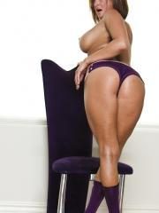 Pictures of Tory Lane showing her big tits and wet pussy on a chair