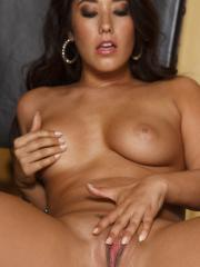 Eva Lovia gets playful and exposes her round breasts