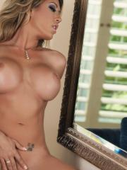 Capri Cavanni strips in the mirror and shows her boobies