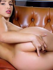 Abella Danger bends over and finger bangs her snatch