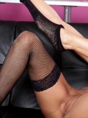 Pictures of blonde girl Natasha Marley spreading her pussy in fishnets