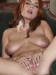 Pictures of redhead girl Ashley Graham gently massaging her aroused clit