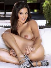 Pictures of Sunny Leone rubbing with her fingers up and down her beaver