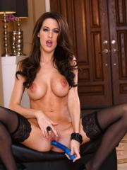 Pictures of Kortney Kane teasing her clit with a new vibrator