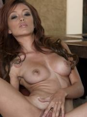 Taylor Ashley lies down on the couch to tease her clit