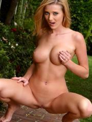 Carli Banks takes a stroll by the garden and fingers her tight pussy